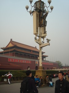 Surveillance cameras and loud speakers at Tiananmen square.