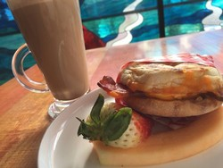 Bacon Egg & Cheese Sandwich with fruit & Giobean organic coffee